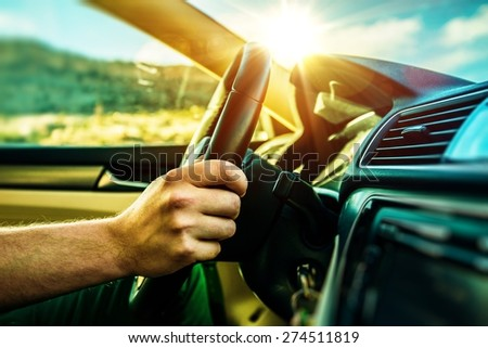Summer Time Car Trip. Car Traveling. Men Driving Down the Road During Scenic Sunset. - stock photo