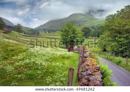 Summer time in the Lake District.  Low Mill Bridge near Grasmere looking towards Great Tongue, Cumbria, England. - stock photo