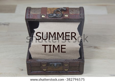 summer time is written on the Brown torn paper in the treasure box. holiday concepts.