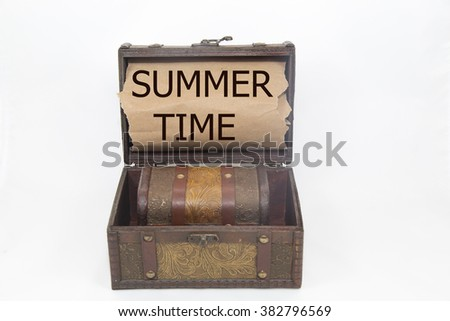 summer time is written on the Brown torn paper in the treasure box. holiday concepts, isolated on white background
