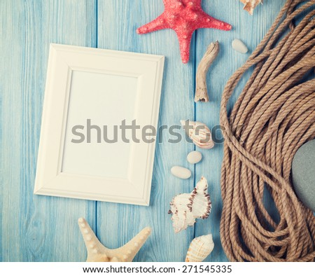 Summer time sea vacation with blank photo frame, star fish and marine rope. Retro toned   - stock photo