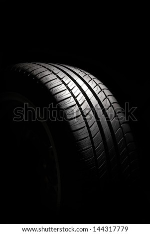 Summer tire isolated on a black background - stock photo