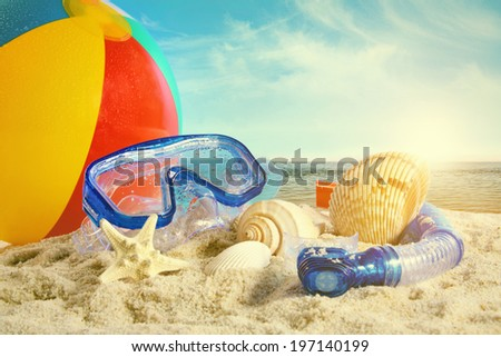 Summer toys at the beach - stock photo