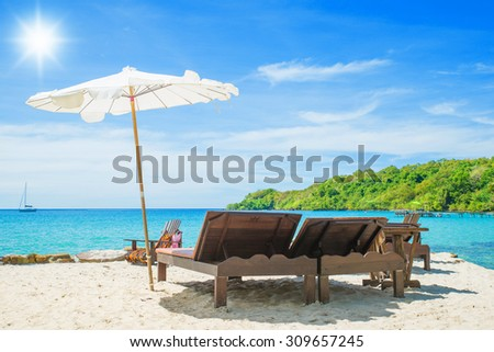Summer, Travel, Vacation and Holiday concept - Beach chair on the beach in sunny day at Phuket, Thailand - stock photo