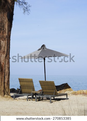 Summer, Travel, Vacation and Holiday concept - Beach chairs and umbrella on wooden desk against blue sky in Moo Koh Surin,Thailand - stock photo