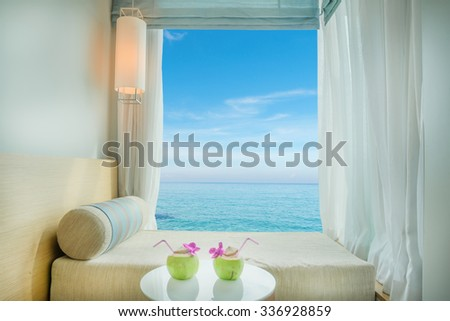Summer, Travel, Vacation and Holiday concept - Beautiful tropical sea view at window in resort, Phuket ,Thailand - stock photo