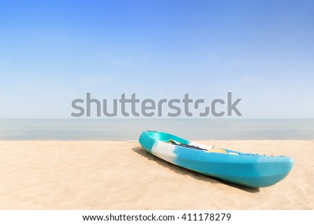Summer, Travel, Vacation and Holiday concept -  Kayak boat on a tropical beach, Thailand. - (Selective focus on kayak boat) - stock photo