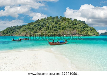Summer, Travel, Vacation and Holiday concept - Longtale boats at the beautiful beach, Thailand - stock photo