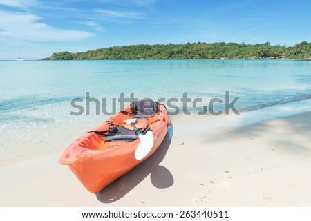 Summer, Travel, Vacation and Holiday concept - Orange kayaks on the tropical beach, Phuket, Thailand - stock photo