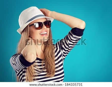 Summer travel woman in hat and sunglasses ready for feast trip and party. Attractive smiling girl thinking of holiday. - stock photo