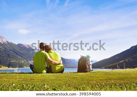 summer travel, young couple of hikers enjoying mountain landscape - stock photo