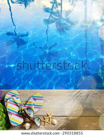 Summer vacation concept--Flipflops on a tropical beach  - stock photo