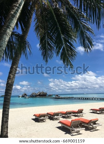 Summer vacation cozy beach white sand with sundeck on the seaview under the palm tree