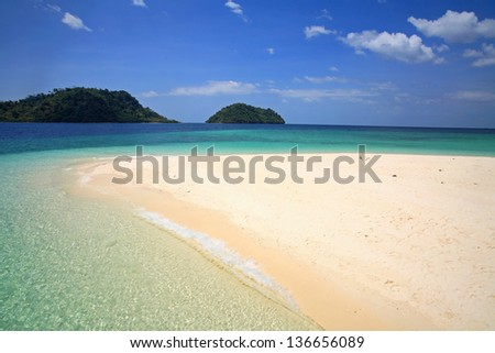 Summer vacation: Crystal Andaman sea and curved beach against blue sky at Koh Lipe in Satun, Thailand - stock photo