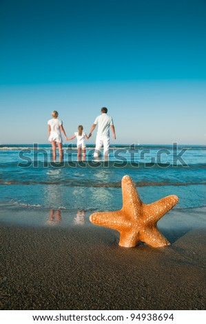 Summer vacation -  family on the beach (space for text) - stock photo