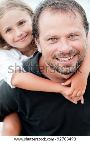 Summer vacation - happy childhood, father with daughter on the beach portrait - stock photo