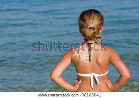 Summer vacation, healthy tanning - lovely girl sunbathing on the beach - stock photo
