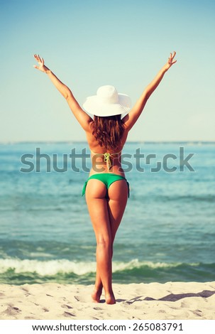summer vacation, holidays and people concept - young woman sunbathing on beach - stock photo
