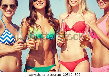 summer vacation, holidays, party, travel and people concept - close up of young women drinking lemonade on beach