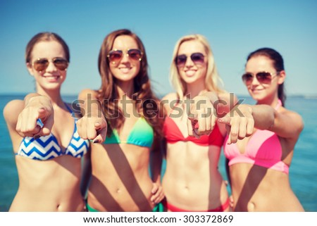 summer vacation, holidays, travel, gesture and people concept - group of happy young women pointing finger on you on beach
