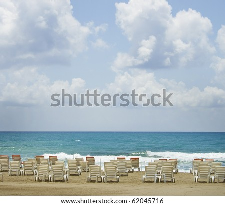 Summer vacation in Mediterranean coast city Alanya (Turkey). Seascape with beach chairs for tourists. - stock photo