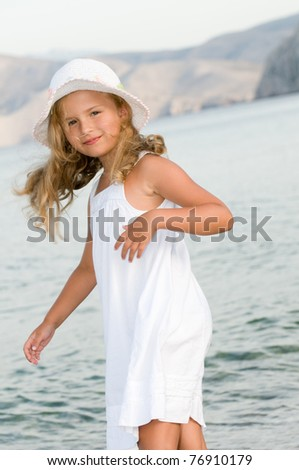 Summer vacation - little girl at the beach
