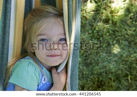 Summer vacation - lovely girl in hammock in the garden