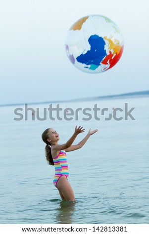 Summer vacation, lovely girl playing in the sea - stock photo