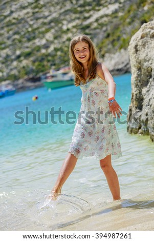 Summer vacation, portrait of beautiful, happy, young girl on the beach  - stock photo