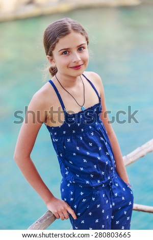Summer vacation, portrait of lovely fashion young girl on the beach - stock photo