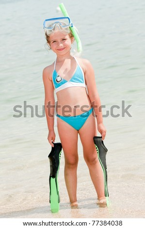Summer vacation - snorkel girl portrait - stock photo