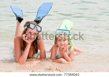 Summer vacation - snorkel girls portrait - stock photo