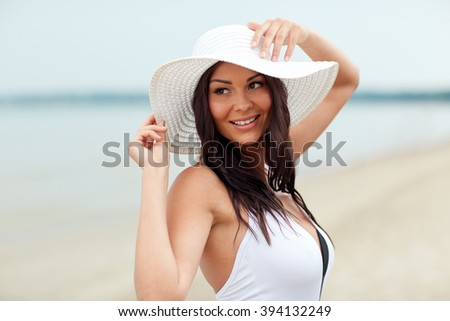 summer vacation, tourism, travel, holidays and people concept -face of happy young woman on beach - stock photo
