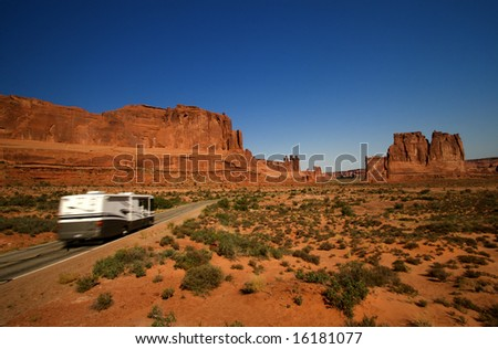 Summer vacation travelers tour through Arches National Park in Utah USA - stock photo