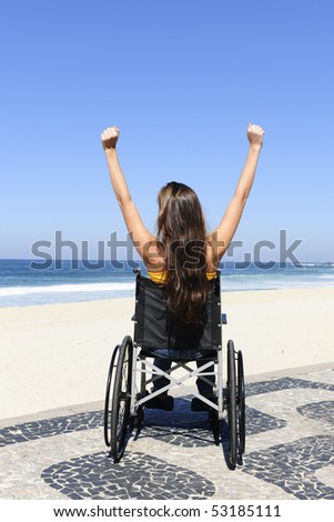 summer vacation: wheelchair person enjoying outdoors beach