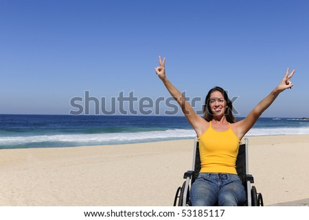 summer vacation: wheelchair person enjoying outdoors beach - stock photo