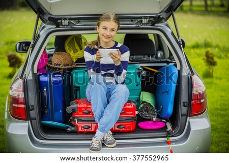 Summer vacation, young girl ready for travel for family vacation - stock photo