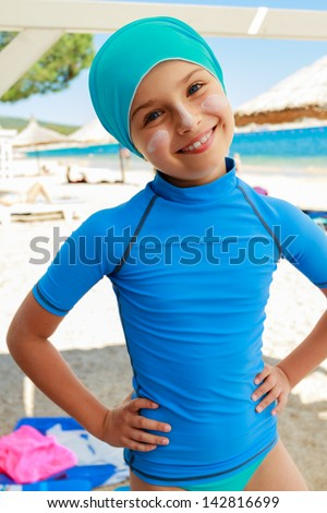 Summer vacation - young surfer girl on the beach, active child concept