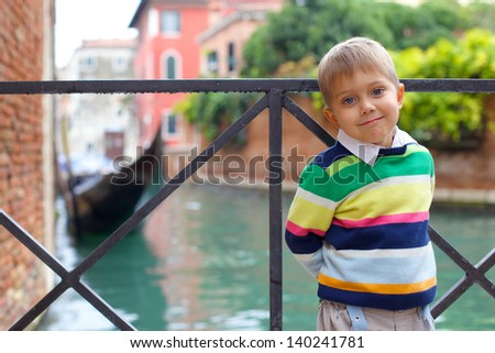 Summer venetian view and tourist boy. Venice, Italy. - stock photo