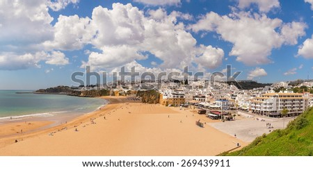 Summer view of Albufeira beach fishermen. White clouds. Portugal. - stock photo