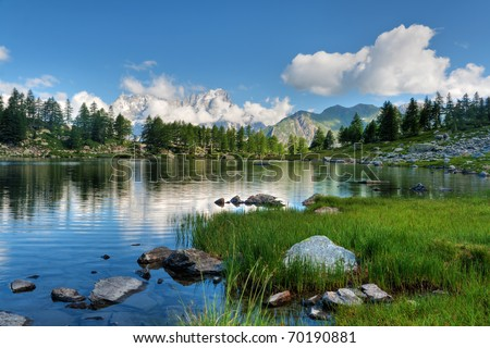 summer view of Arpy lake near La Thuile, Aosta valley, Italy. Image processed with hdr technique - stock photo