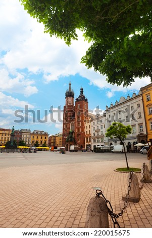 Summer view of beautiful Saint Mary's Basilica and Rynek Glowny (main square) Krakow, Poland - stock photo