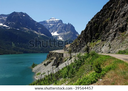 Summer view of blue lake and snow mountains in glacier national park, montana, usa - stock photo