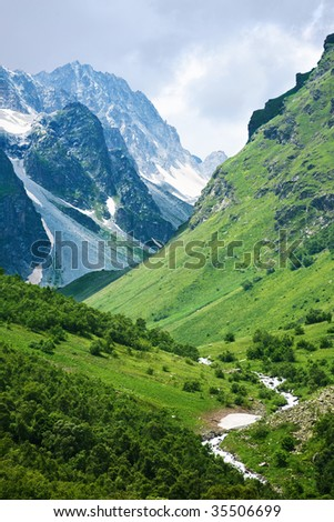 Summer view of Caucasus mountains Dombain. Dombai, Russia.