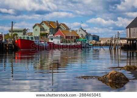 Summer view of fishermen houses and harbor at Peggy's Cove, Nova Scotia, Canada. - stock photo