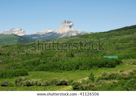Summer view of meadows, forests and mountain in glacier national park, montana, usa - stock photo