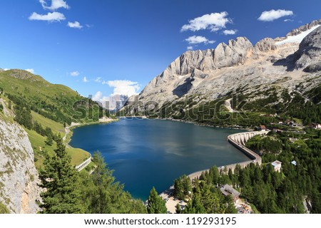 summer view of mount Marmolada and Fedaia lake, Trentino, Italy