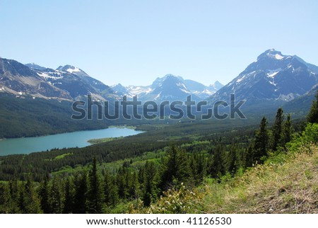 Summer view of mountain and lake in glacier national park, montana, usa - stock photo