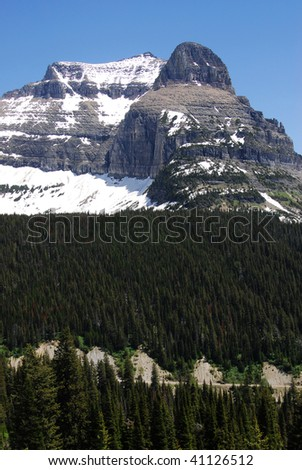 Summer view of mountain road on slope in glacier national park, montana, usa - stock photo
