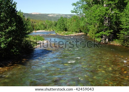 Summer view of mountains and river in glacier national park, montana, usa - stock photo